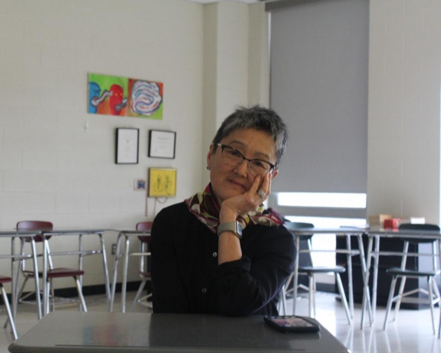 Ms. Malueg sitting in her classroom. Photo by Kevin Rueda.