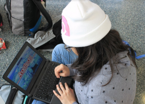 Xochilt Estrada (Adv. 204) watches Anime during her lunch. Photo by Iliana Garner.