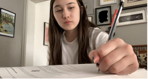 Mai-Linh Weller taking an SAT practice test (Adv.203)